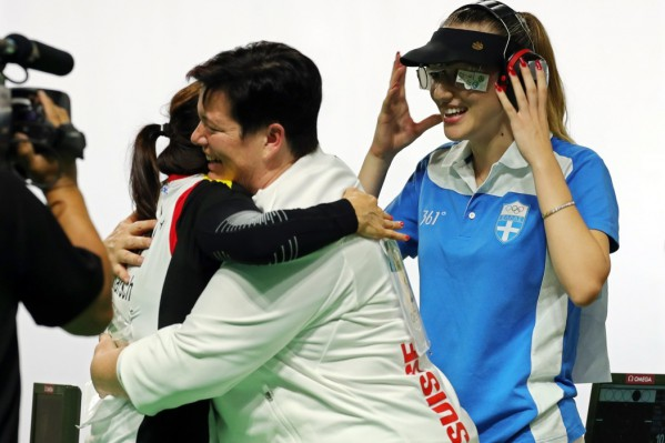 epa05468549 Anna Korakaki (R) of Greece celebrates after winning the women's 25m Pistol gold medal match of the Rio 2016 Olympic Games Shooting events at the Olympic Shooting Centre in Rio de Janeiro, Brazil, 09 August 2016. Korakaki won the gold medal ahead of second placed Monika Karsch (L) of Germany and third placed Heidi Diethelm Gerber (C) of Switzerland.  EPA/ARMANDO BABANI