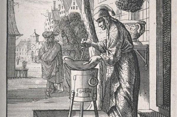 Φαρμακοποιός του Μεσαίωνα, ενώ ετοιμάζει κάποιο σκεύασμα, στο δρόμο έξω από το φαρμακείο του.